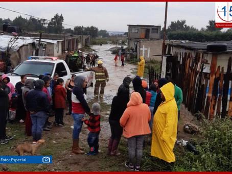 Evacúan por desbordamiento a 11 familias en Texmelucan