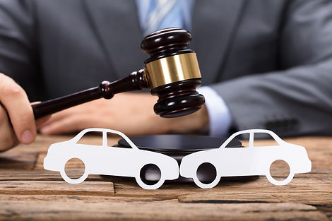 Midsection of judge hitting mallet by paper cars on wooden table.jpg