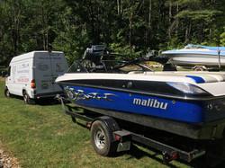 A blue Malibu ski boat