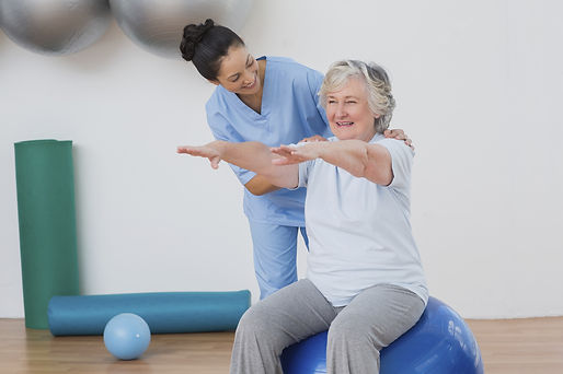 Instructor-assisting-senior-woman-during-physical-therapy.jpg