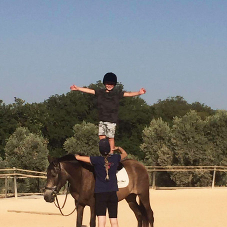 Young Ronnie Having Fun Horse Riding