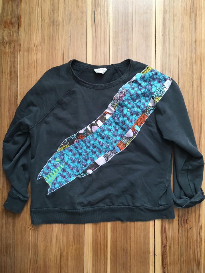 Festive eel on sweatshirt