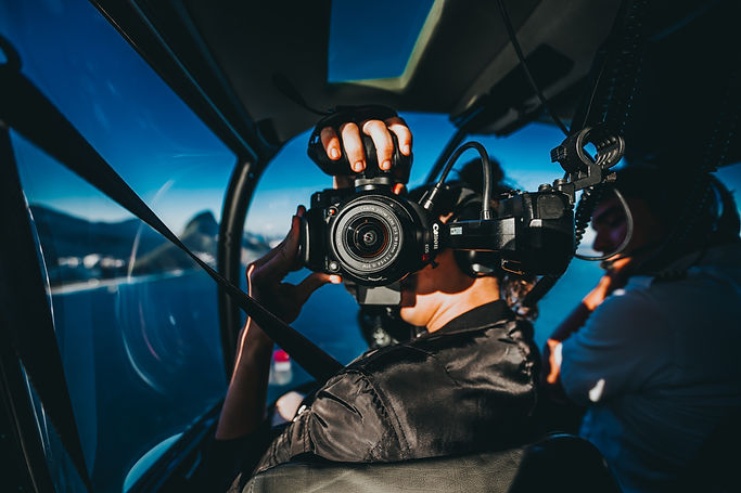 Woman with camera in a helicopter