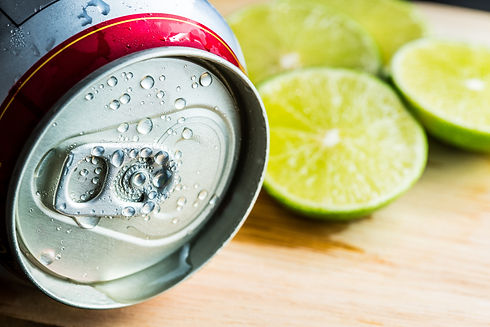Beer Can With Lime Slice On Wooden Table