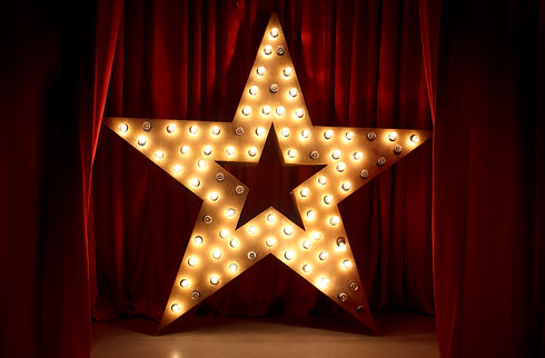 Photo of golden star with light bulbs on