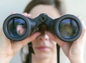 Girl looking through the binoculars. Fin