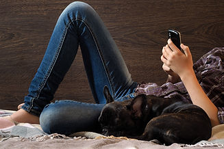 Legs, human hands, teenager. Mobile dog.