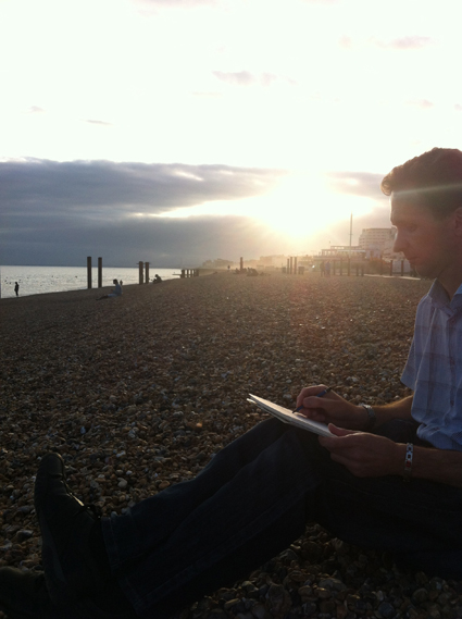 Student drawing on Brighton beach