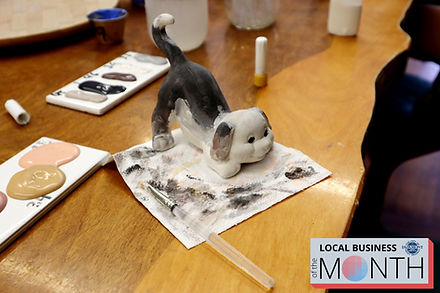 Painted dog pottery at Mountain Creative