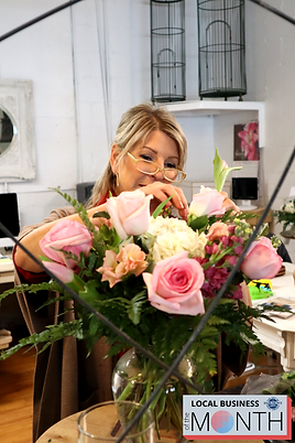 Robin Wood arranging a bouquet of flowers