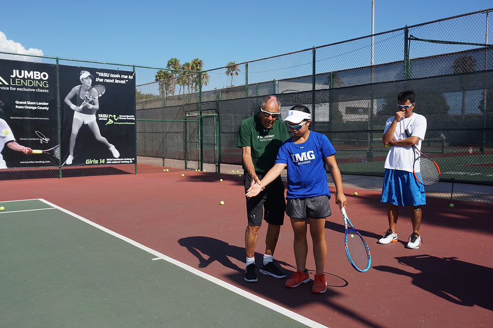 Stacey Samonte with her coach Orlando Silvoza and Nick Bollettieri