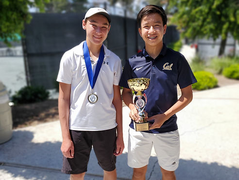 Grant Gallagher and Alan Ton showing off their 4th and first place trophies at the Level 3 National USTA tournamet in RCI