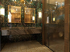 3D-rendering-hospitality-design-marble-countertop-matte-black-washbasin-gold-mirrors-glass-enclosed-shower-rainforest-tiles-on-walls