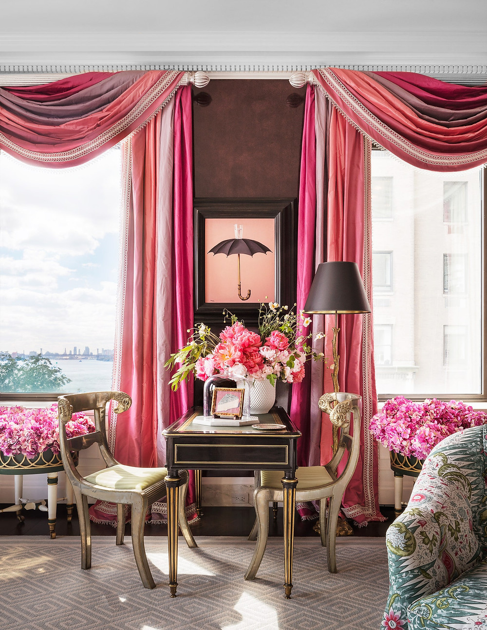 Three different silks, two by Kravet and one by Brunschwig & Fils, make up the living room curtains in a Manhattan duplex designed by Mario Buatta.