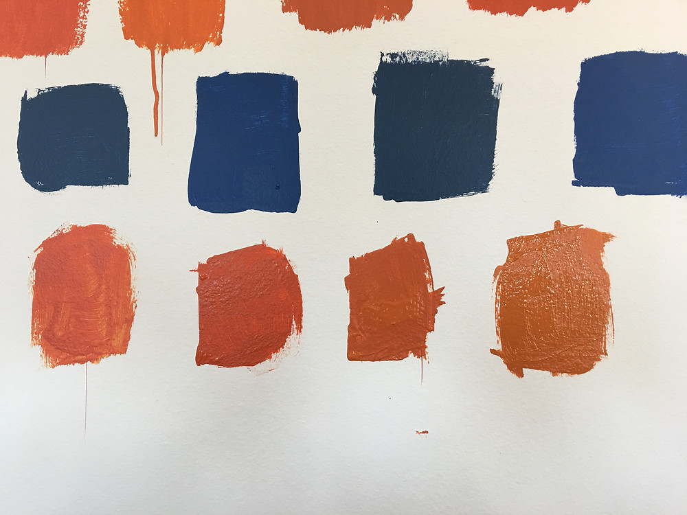 blue and orange paint samples for game room remodel project