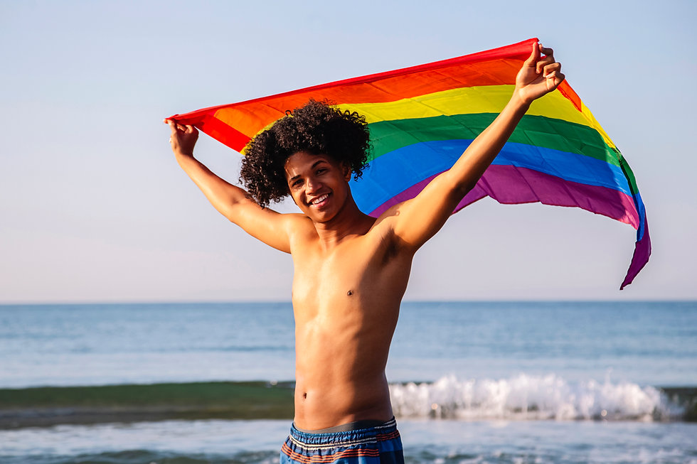 young-latino-man-with-afro-hair-showing-lgtbi-flag-2L7ZJUH.jpg