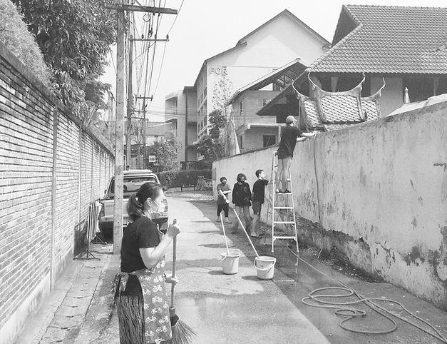 POR Thapae Gate eco team washes temple wall