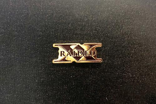 X-Raided lapel pin