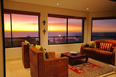 Oceana Villa Bloubergstrand self catering accommodation.  Sun room overlooking Robben Island