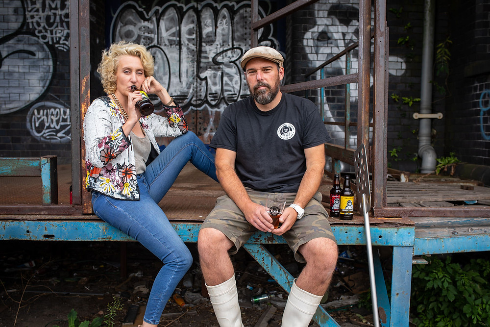 Owners of New Bristol Brewery with graffiti in the background