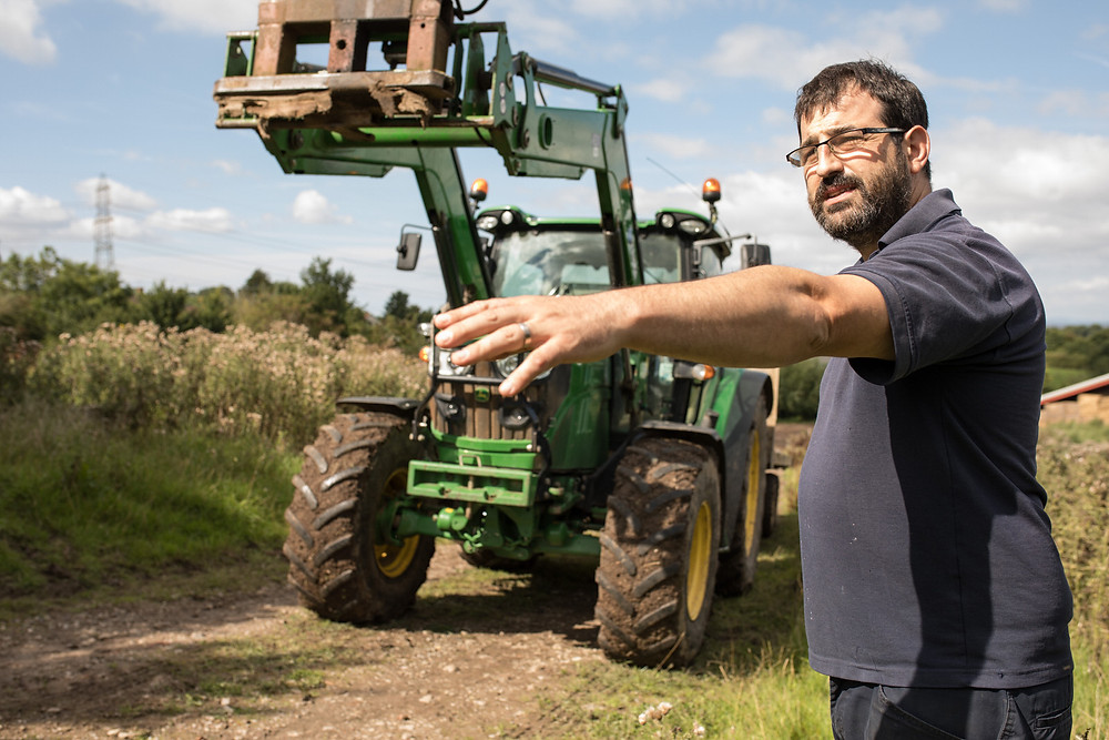 Bristol commercial photography - man standing in front of tractor