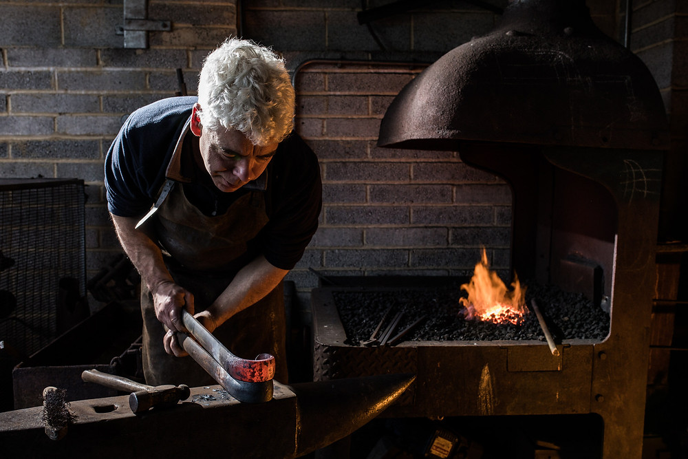 Bristol commercial photography by Havelock - metal working blacksmith by furnace