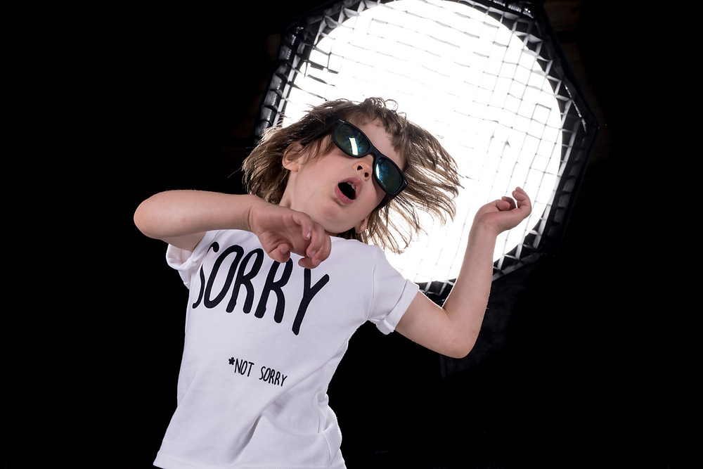 Kid wearing Zero Fox clothing dancing in front of a light