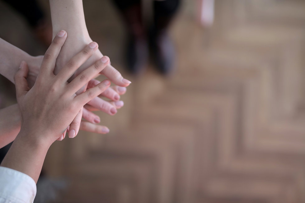 crop-group-stacking-hands-together-38307