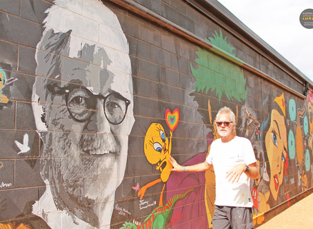 Kids in Outback NSW learning the value of street art, thanks to art doyen