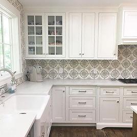 A quaint farmhouse style Asheville home got a brand new kitchen and porch renovation.