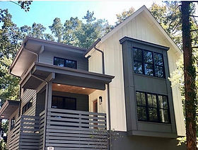 This new construction urban farmhouse is in the heart of historic Kenilworth. It's bold black and white exterior partner with a traditional interior for perfect Asheville family life.