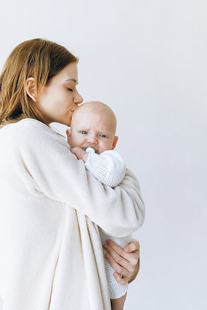 woman-in-white-robe-carrying-baby-384540
