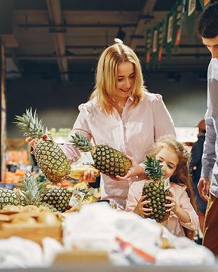 family-buying-fresh-pineapples-3985067.j