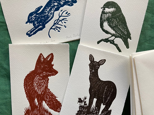 A set of 4 mini-linocuts