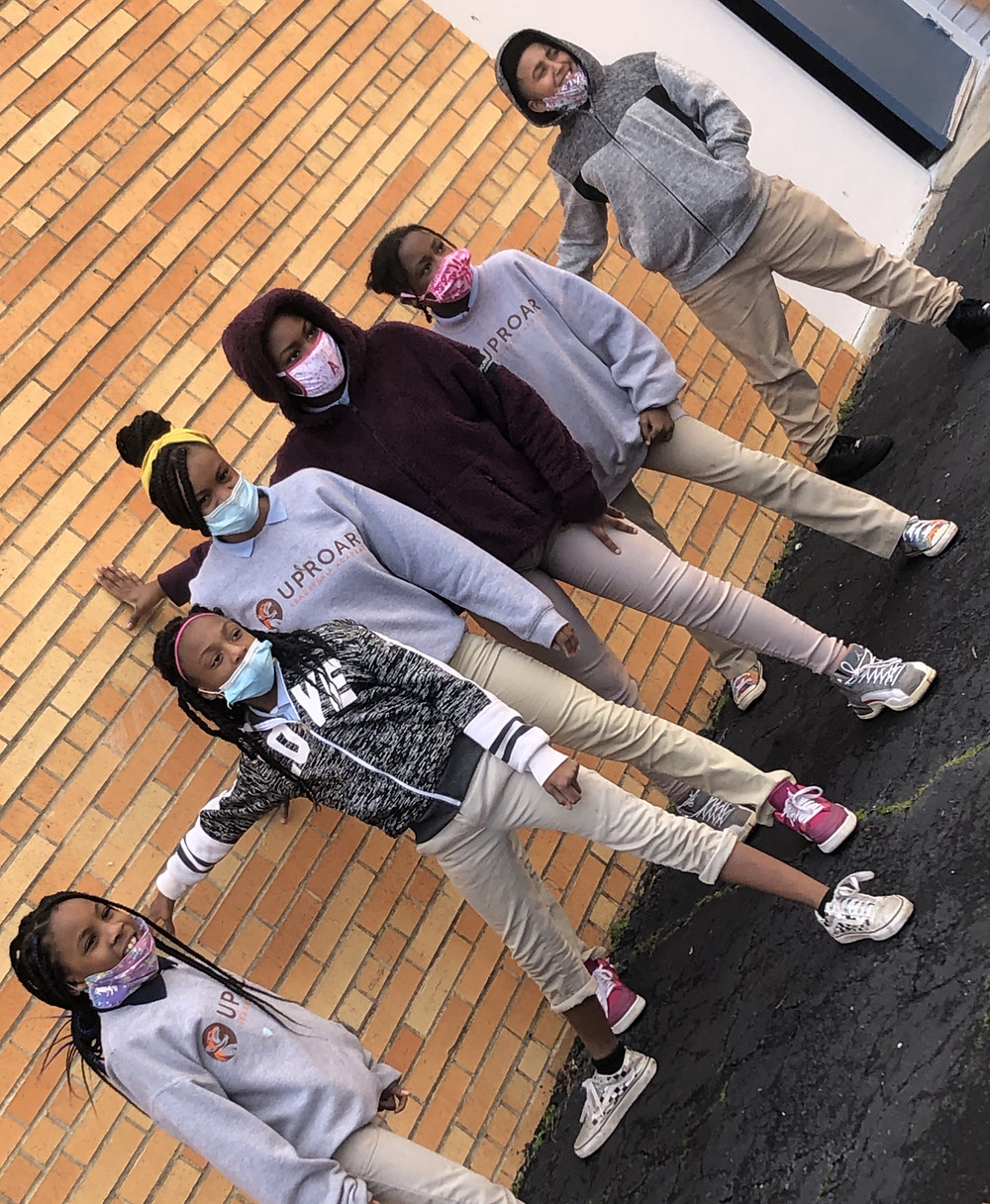 UpROAR Leadership Academy and students outside with masks