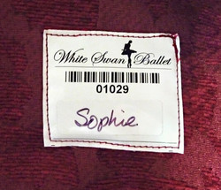 Sew-in tag with adhesive label