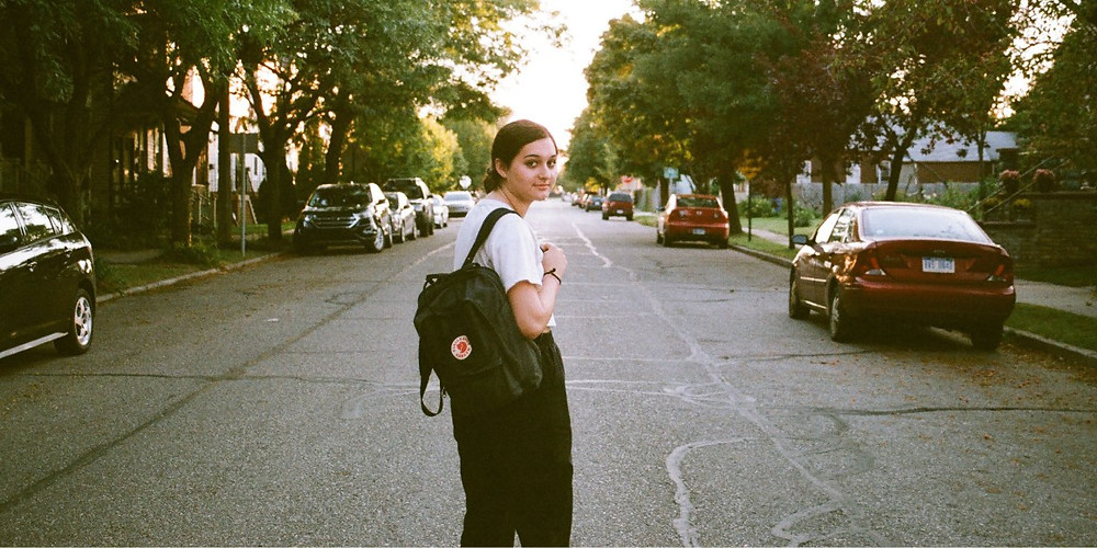 Christina Stoever posing with her backpack