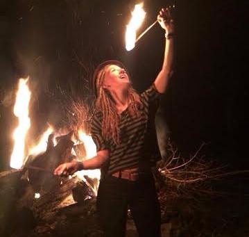Alumna eats, spins fire