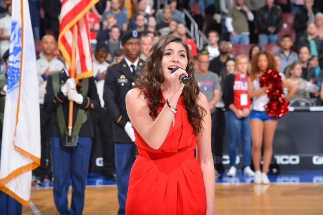 Gabby singing the Anthem