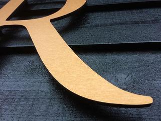 haarrevolutie gevelreclame letter brons