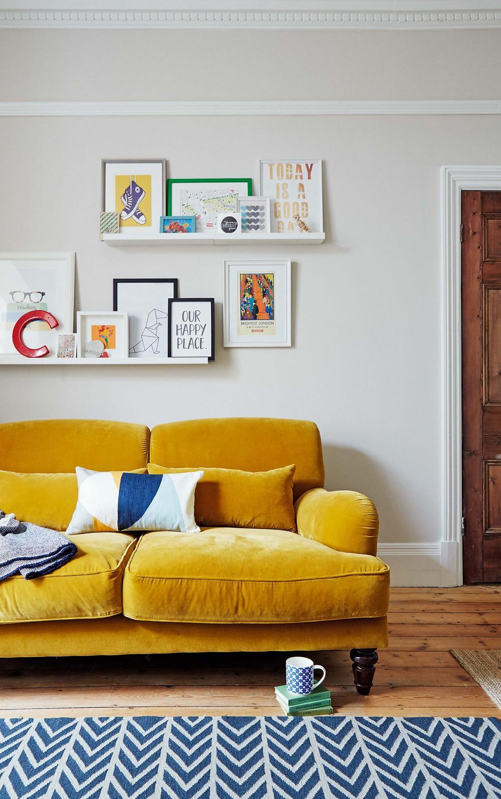 Overlapping wall art on shelves