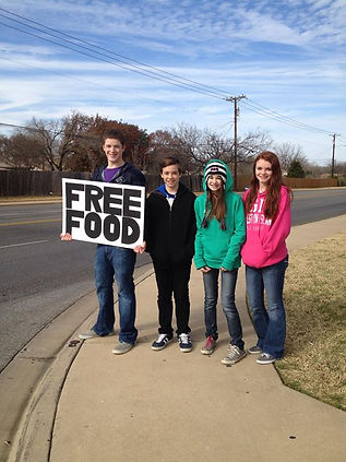 "Love Serve Feed - ""FREE FOOD"" sign"