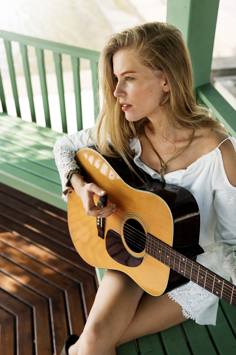 Girl practicing on her guitar