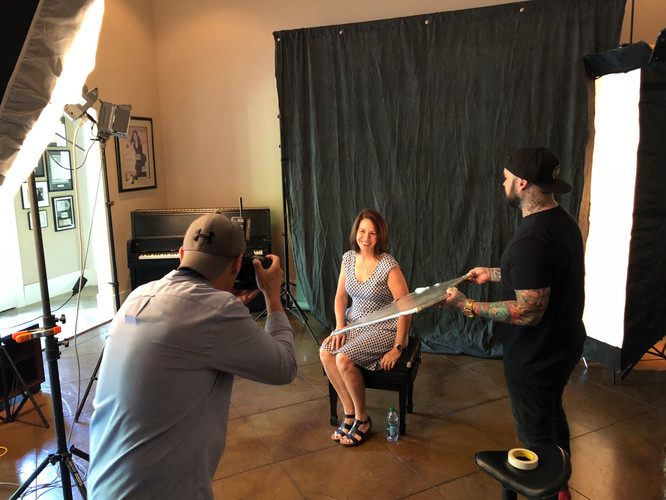 Laurie has her headshot taken for the PCG Universal website
