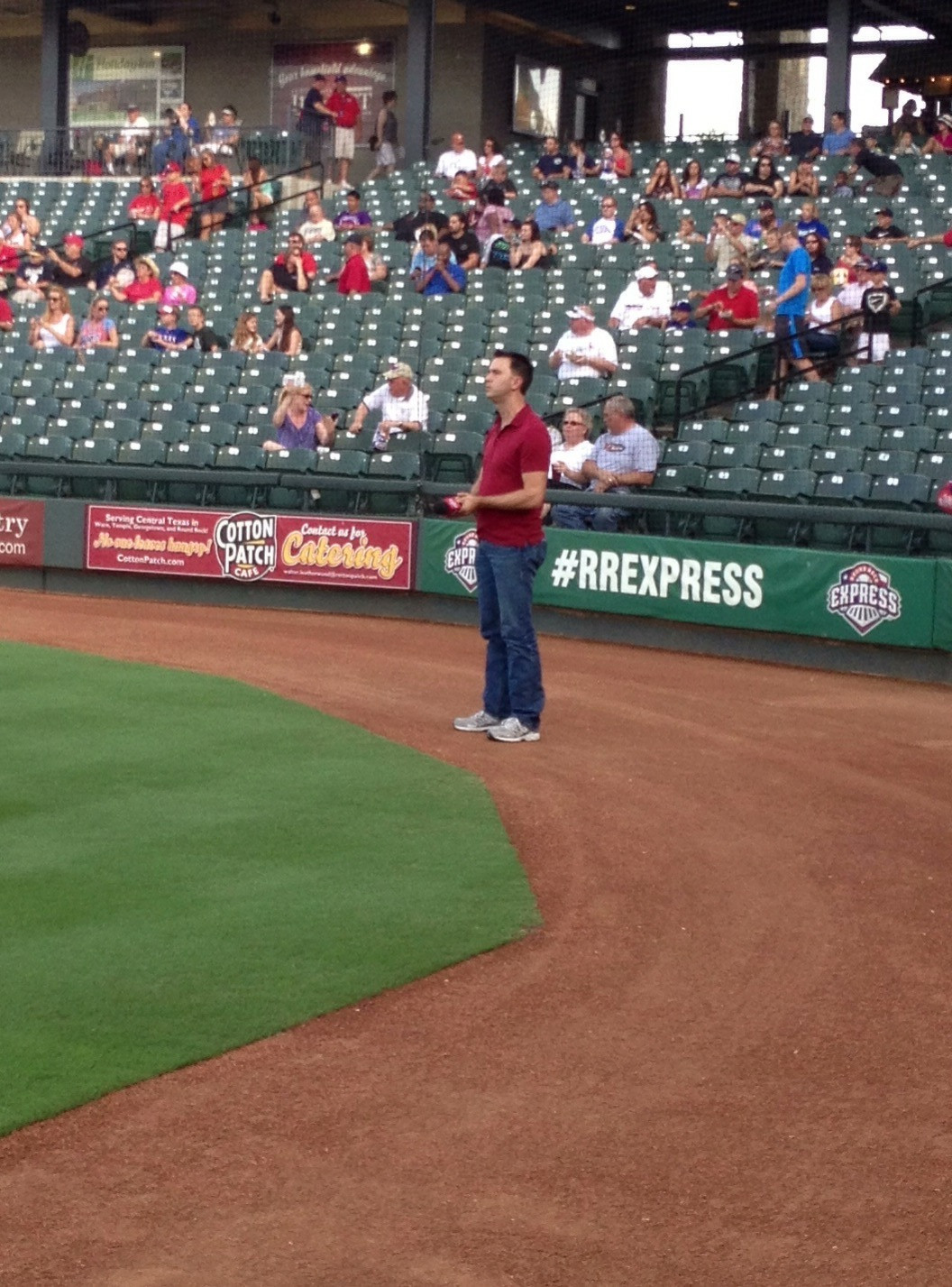 Ray sings the National Anthem at the Dell Diamond