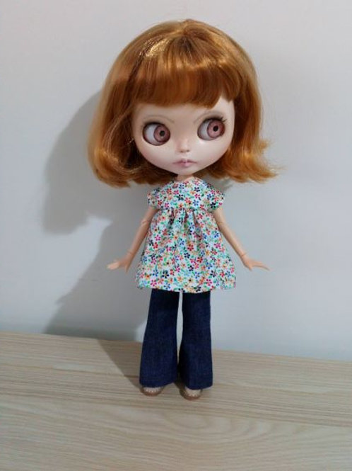 Blythe Bell Bottom Jeans and  Multi Flower Print Smock Top.