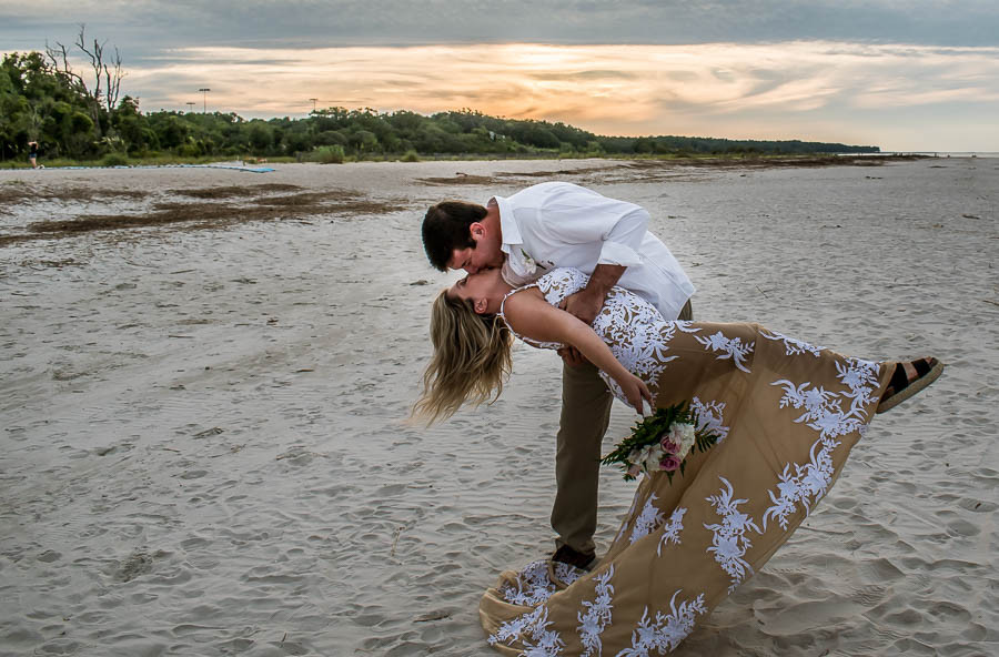 beach elopement with a dipped kiss at sunset