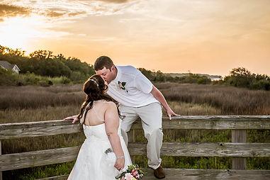 sunset beach wedding on hilton head island, kiss on the boardwalk at Fish Haul Beach