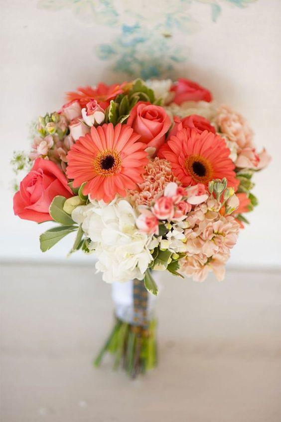 coral color bridal bouquet being held by bride at a park in coastal south carolina SC