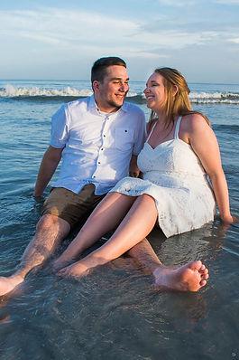 fun beach wedding phots, bride and groominthe water